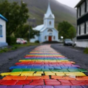 rainbow street leading to a church
