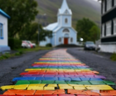 rainbow street leading to a church