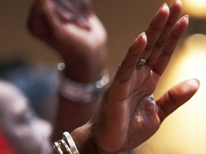 Hands in worship at MCC churches