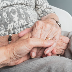 holding an elderly persons hand