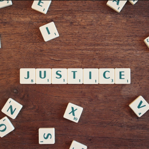justice spelled out with tiles