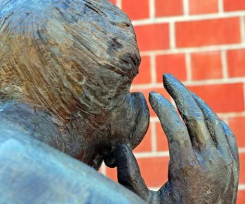 statue of a man listening